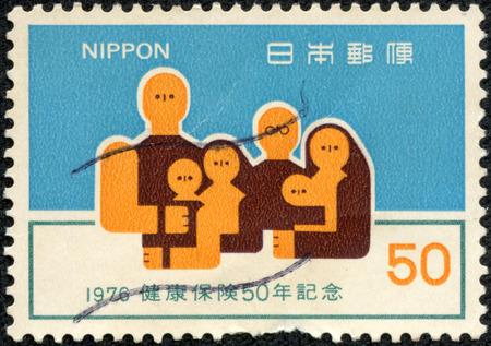 JAPAN - CIRCA 1976  A stamp printed in japan shows Family, circa 1976