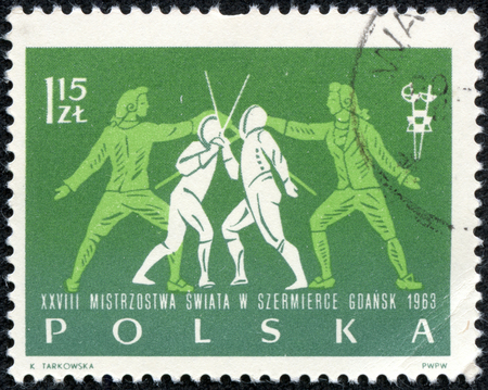 fencers: POLAND - CIRCA 1963: post stamp printed in Polska shows two fighting fencers, 28th world fencing championships Gdansk, Scott 1147 A402 40g blue, circa 1963