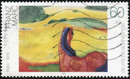 printmaker: GERMANY - CIRCA 1992: a stamp printed in the Germany shows Landscape with a Horse, Painting by Franz Marc, circa 1992