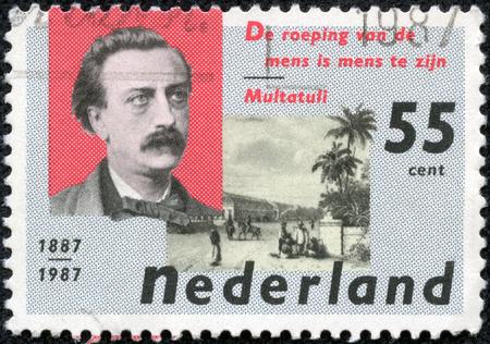 eduard: NETHERLANDS - CIRCA 1987: a stamp printed in the Netherlands shows Eduard Douwes Dekker and De Harmonie Club, Batavia, circa 1987
