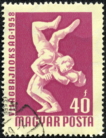 commemorative: HUNGARY - CIRCA 1958  A stamp printed in Hungary honoring World Wrestling Championships, Budapest, shows Wrestlers, circa 1958 Stock Photo