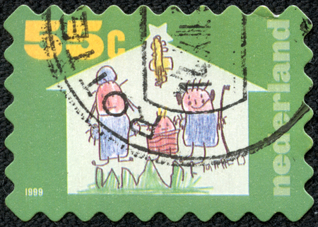 entries: NETHERLANDS - CIRCA 1999  A Christmas greeting stamp printed in the Netherlands shows Winning entries in design competition, Baby with angel wings  Rosmarijn Schmink , series, circa 1999 Stock Photo