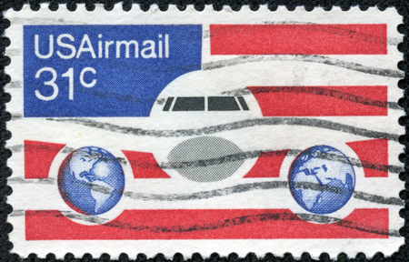 franked: USA-CIRCA 1976  A 31 cent United States Airmail postage stamp, shows image of Plane and Globes on red white and blue , circa 1976