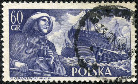 fryderyk chopin: POLAND - CIRCA 1956  Blue color stamp printed in Poland with image of a sailor in raincoat over the Polish training vessel named Fryderyk Chopin, circa 1956  Editorial