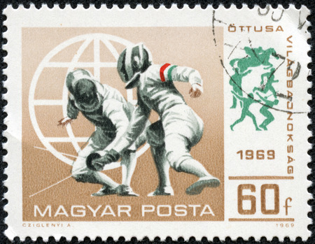 Hungary - CIRCA 1969  A stamp printed in Hungary shows a fencing competitions, circa 1969 photo