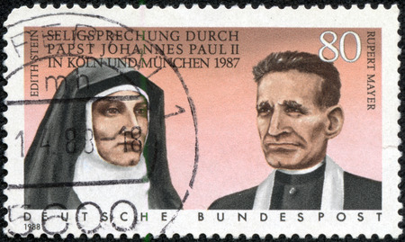 beatification: GERMANY - CIRCA 1988: A stamp printed in German Federal Republic shows Beatification of Edith Stein and Rupert Mayer by Pope John Paul II in 198, circa 1988