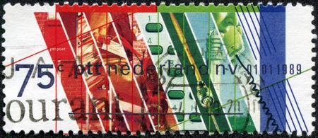 privatization: NETHERLANDS - CIRCA 1989: Stamp printed in Netherlands honoring Privatization of Netherlands PTT. Postal and Telecommunications Services, circa 1989