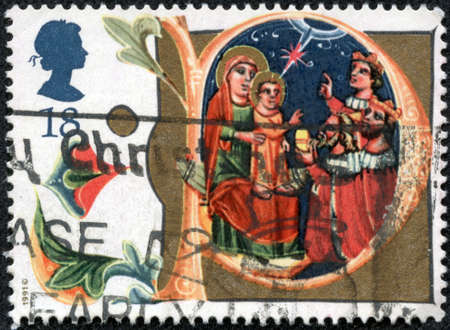 adoration: UNITED KINGDOM - CIRCA 1991: A stamp printed in United Kingdom from the Christmas  issue shows Adoration of the Magi, Manuscript in Bodleian Library, Oxford, circa 1991. Editorial