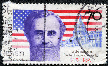 elected: GERMANY - CIRCA 1976: a stamp printed in the Germany shows Carl Schurz who Became first German-born American Elected to the US Senate, American Flag and Capitol, American Bicentennial, circa 1976