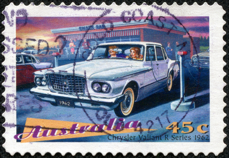 AUSTRALIA - CIRCA 1997  a postage stamp printed in Australia showing an image of a car model Chrysler Valiant R Series 1962, circa 1997  版權商用圖片