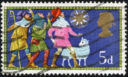 philatelic: UNITED KINGDOM - CIRCA 1969  A stamp printed in United Kingdom shows Three shepherds, circa 1969 Stock Photo