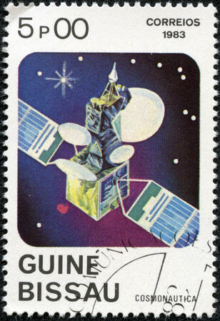 researches: GUINEA-BISSAU - CIRCA 1983  A stamp printed in Guinea-Bissau shows Space Communication, circa 1983 Stock Photo