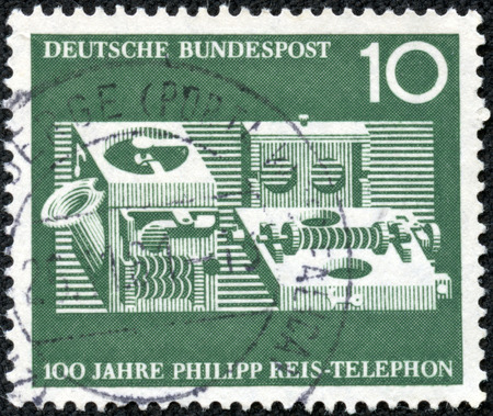 GERMANY - CIRCA 1961  a stamp printed in the Germany shows Reis Telephone, Centenary of the Demonstration of the 1st Telephone by Philipp Reis, circa 1961 photo