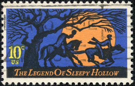 pursuing: USA - CIRCA 1974  A postage stamp printed in USA, Legend of Sleepy Hollow, by Washington Irving  Design features Headless Horseman pursuing Ichabod Crane, circa 1974