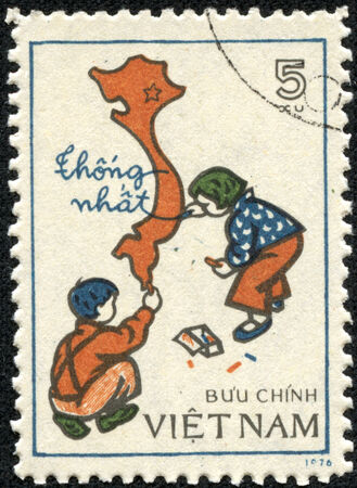 VIETNAM - CIRCA 1976  A stamp printed in Vietnam showing children drawing a map of Vietnam, circa 1976 photo
