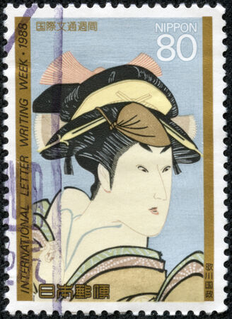 JAPAN - CIRCA 1988  A stamp printed in Japan dedicated to international letter writing week, shows painting of a Japanese woman, circa 1988