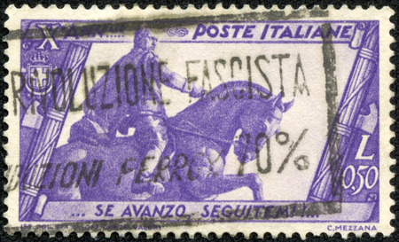 fascist: ITALY-CIRCA 1933 A stamp printed in ITALY shows image of the Benito Amilcare Andrea Mussolini  29 July 1883 - 28 April 1945  was an Italian politician who led the National Fascist Party, circa 1933