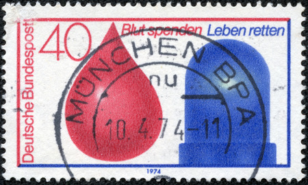 in conjunction: GERMANY - CIRCA 1974  a stamp printed in the Germany shows Drop of Blood and Police Car Light, Blood Donor Service in Conjunction with Accident Emergency Service, circa 1974 Editorial