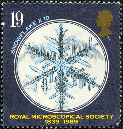 microscopical: GREAT BRITAIN - CIRCA 1989  a stamp printed in the Great Britain shows Snowflake under Microscope, 150th anniversary of Royal Microscopical Society, circa 1989