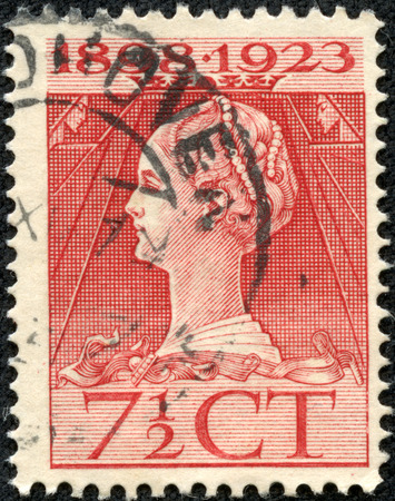 wilhelmina: NETHERLANDS - CIRCA 1923  a stamp printed in the Netherlands shows Queen Wilhelmina, 25th Anniversary of the Assumption as Monarch of the Netherlands, circa 1923 Editorial