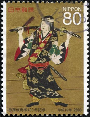 kabuki: JAPAN - CIRCA 2003  A stamp printed in Japan, dedicated to the 400th anniversary of Kabuki theater, shows Okuni Kabuki-zu, detail from painted screen, circa 2003