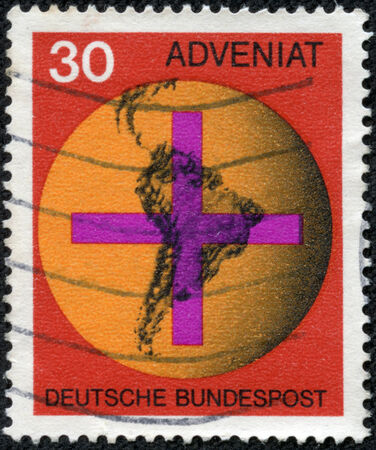 bundespost: GERMANY - CIRCA 1967  A stamp printed in Federal Republic of Germany honoring Adveniat - Aid for Catholic Church in Latin America, shows Cross on South American Map, circa 1967 Editorial
