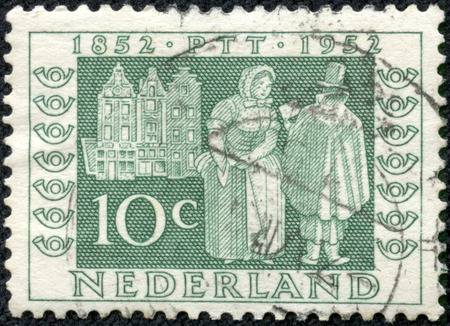 orange nassau: NETHERLANDS - CIRCA 1952  A stamp printed in the Netherlands from the  Netherlands Stamp Centenary and Centenary of Telegraph Service  issue shows Postman delivering letters, 1852, circa 1952