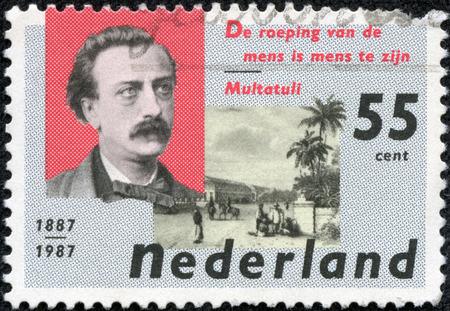eduard: NETHERLANDS - CIRCA 1987  a stamp printed in the Netherlands shows Eduard Douwes Dekker and De Harmonie Club, Batavia, circa 1987