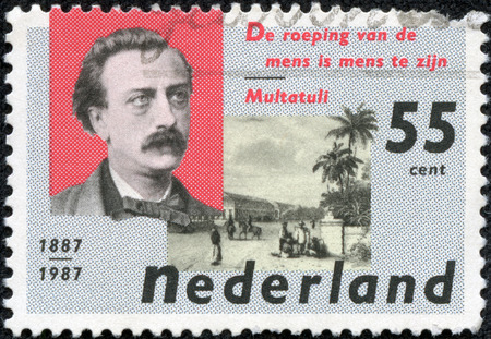 NETHERLANDS - CIRCA 1987  a stamp printed in the Netherlands shows Eduard Douwes Dekker and De Harmonie Club, Batavia, circa 1987