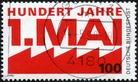 GERMANY - CIRCA 1990  A stamp printed in Germany, is dedicated to the 100th anniversary of International Workers  Day, 1st May, circa 1990