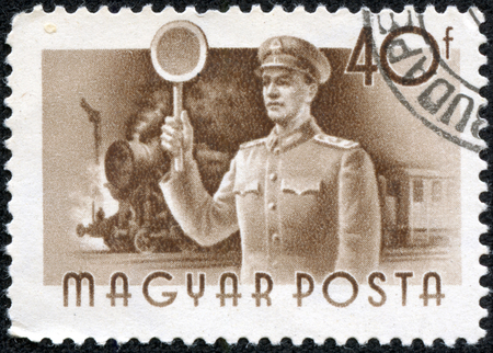 magyar: HUNGARY - CIRCA 1955   A stamp printed in Hungary shows Railway guard and train without inscription, from the series  Hungary Workers , circa 1955