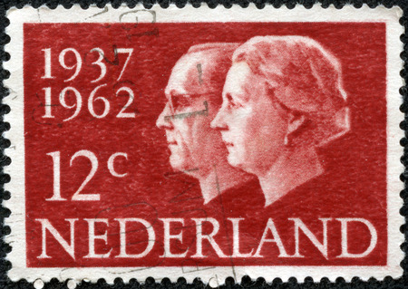 regnant: NETHERLANDS - CIRCA 1962  A stamp printed in the Netherlands, is dedicated to the 25th anniversary of the wedding, Queen Juliana and Prince Bernhard, circa 1962