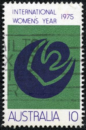 womanhood: AUSTRALIA - CIRCA 1975  a stamp printed in the Australia shows Symbols of Womanhood, Sun, Moon, International Women s Year, circa 1975