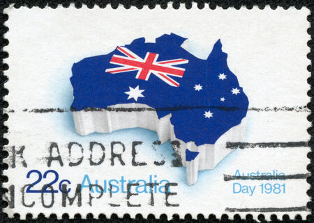 AUSTRALIA - CIRCA 1981  A stamp printed in Australia shows flag of Australia placed in the contour of the continent, circa 1981 photo
