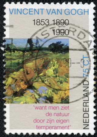 NETHERLANDS - CIRCA 1990  A stamp printed in the Netherlands shows The Green Vineyard, Detail of Painting by Vincent van Gogh, circa 1990 photo