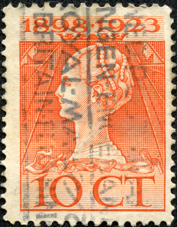 NETHERLANDS - CIRCA 1923  a stamp printed in the Netherlands shows Queen Wilhelmina, 25th Anniversary of the Assumption as Monarch of the Netherlands, circa 1923 Editorial