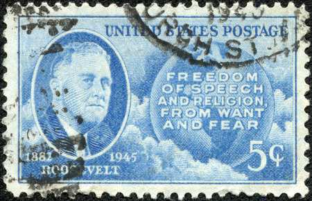 USA - CIRCA 1945  Postage stamp printed in the USA, shows a portrait of 32th President of the United States, Franklin Delano Roosevelt, Globe and Four Freedoms, circa 1945