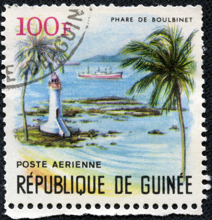 GUINEA - CIRCA 1966  A post stamp printed in Guinea shows lighthouse Phare de Boulbinet series, Lighthouses of Guinea, circa 1966 photo
