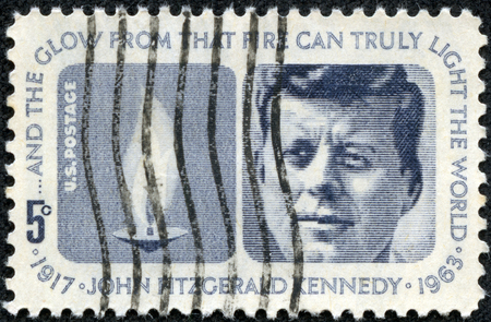 john fitzgerald kennedy: UNITED STATES - CIRCA 1964  stamp printed in United states  USA , shows Flame and portrait of John Fitzgerald Kennedy  1917-1963 , with the same inscription, from series  Kennedy Memorial  circa 1964