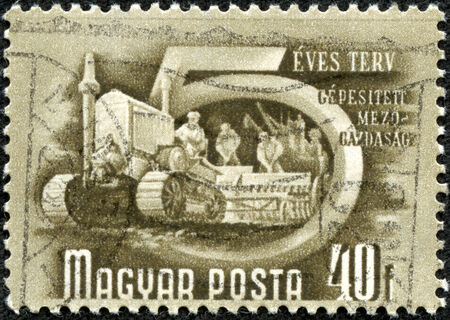 HUNGARY - CIRCA 1950   A stamp printed in Hungary shows Mechanical agriculture with the inscription  Five-Year-Pla n , from the series  Hungary s Five-Year-Plan  ; ;, circa 1950 photo