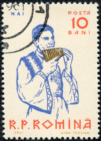 panpipe: ROMANIA-CIRCA 1961 A stamp printed in ROMANIA shows image of The pan flute or pan pipe is an ancient musical instrument based on the principle of the closed tube, circa 1961  Editorial