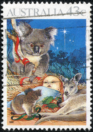 AUSTRALIA - CIRCA 1990  Postage stamp printed in Australia, Christmas Issue, shows Baby Jesus Nativity, koala and kangaroo, circa 1990 photo