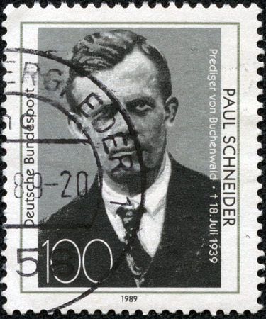 nazis: GERMANY-CIRCA 1989 A stamp printed in Germany shows image of Paul Schneider who was a Church of the Prussian pastor   was the first Protestant minister to be martyred by the Nazis, circa 1989