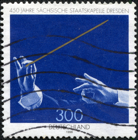 instrumentalist: GERMANY- CIRCA 1998  stamp printed by Germany, shows Saxony State Orchestra Dresden, circa 1998  Editorial