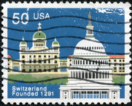 USA - CIRCA 1991  A stamp printed in USA issued for the 700th anniversary of Swiss Confederation shows Federal Palace, Bern and Capitol, Washington, circa 1991