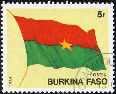 BURKINA FASO - CIRCA 1985  stamp printed by Burkina Faso, shows National Flag, circa 1985  Stock Photo