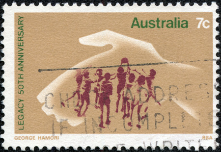 play date: AUSTRALIA - CIRCA 1973  Postage stamp printed in Australia, dedicated to the 50th anniversary of Legacy, shows Hand Protecting Playing Children, circa 1973