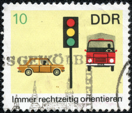 GDR  EAST GERMANY  - CIRCA 1960s  a stamp printed in GDR  East Germany  shows car, truck and light signal, devoted to the explaining rules of the road, circa 1960s Stock Photo