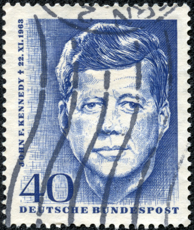the statesman: GERMANY - CIRCA 1963  Postage stamp printed in Germany , shows John F  Kennedy, 35th President of USA 1961-1963, circa 1963 Editorial
