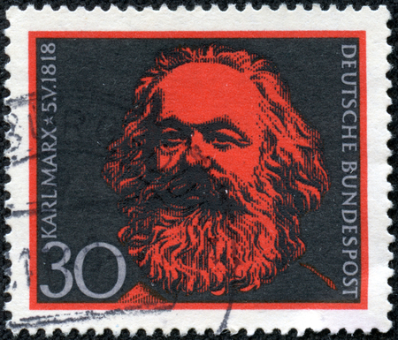 political economist: GERMANY - CIRCA 1968  A stamp printed in Germany issued for the 150th birth anniversary of Karl Marx shows Karl Marx, circa 1968